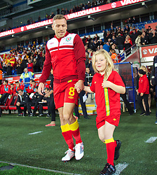 CARDIFF, WALES - Friday, October 11, 2013: Wales' Craig Bellamy walks out for his final home game for his country with his daughter Lexie before the 2014 FIFA World Cup Brazil Qualifying Group A match against Macedonia at the Cardiff City Stadium. (Pic by David Rawcliffe/Propaganda)