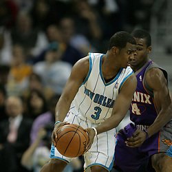 03 December 2008:  New Orleans Hornets guard Chris Paul (3) guarded by Phoenix Suns guard Sean Singletary (14) during a 104-91 victory by the New Orleans Hornets over the Phoenix Suns at the New Orleans Arena in New Orleans, LA..