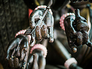 10 SEPTEMBER 2013 - BANGKOK, THAILAND:  The hands of a Buddha statue in a Chinese Shrine in Bangkok, Thailand.      PHOTO BY JACK KURTZ