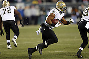 New Orleans Saints running back Mark Ingram (22) runs for a first quarter first down and a gain of 17 yards on the Saints first offensive series during the NFL NFC Wild Card football game against the Philadelphia Eagles on Saturday, Jan. 4, 2014 in Philadelphia. The Saints won the game 26-24. ©Paul Anthony Spinelli