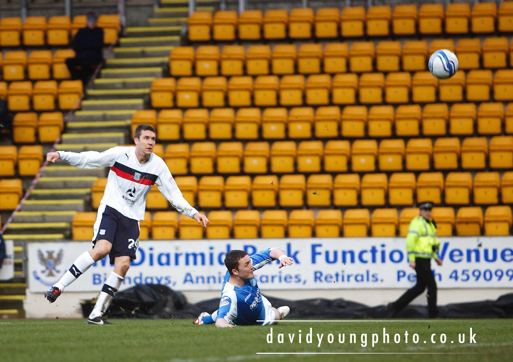 St Johnstone's Thomas Scobbie blocks Colin Nish's shot - St Johnstone v Dundee, Clydesdale Bank Scottish Premier League at McDiarmid Park, Dundee.. - © David Young - www.davidyoungphoto.co.uk - email: davidyoungphoto@gmail.com