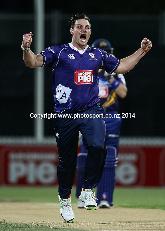 Auckland Ace's Mitchell McClenaghan celebrates the wicket of Otago Volt's Jesse Ryder during the Georgie Pie Super Smash T20 cricket match - Volts v Aces at Seddon Park, Hamilton, New Zealand on Saturday 1 November 2014.  Photo: Bruce Lim / www.photosport.co.nz