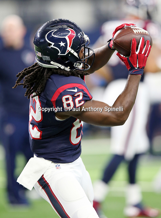 Houston Texans wide receiver Keshawn Martin (82) catches a pass while warming up before the 2015 NFL preseason football game against the Dallas Cowboys on Thursday, Sept. 3, 2015 in Arlington, Texas. The Cowboys won the game 21-14. (©Paul Anthony Spinelli)