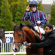 King Of Kudos and K T O'Neil winning the 12.00 race