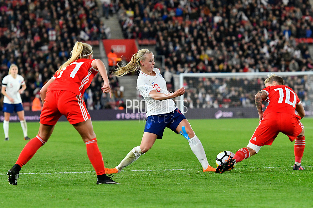 Bethany Mead (18) of England is tackled by Jessica Fishlock (10) of Wales during the FIFA Women's World Cup UEFA Qualifier match between England Ladies and Wales Women at the St Mary's Stadium, Southampton, England on 6 April 2018. Picture by Graham Hunt.