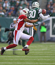 Dec 2, 2012; East Rutherford, NJ, USA; New York Jets free safety LaRon Landry (30) intercepts a pass from Arizona Cardinals quarterback Ryan Lindley (14) during the first half at MetLIfe Stadium.