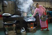 Nun cookng lunch, Mandalay, Burma