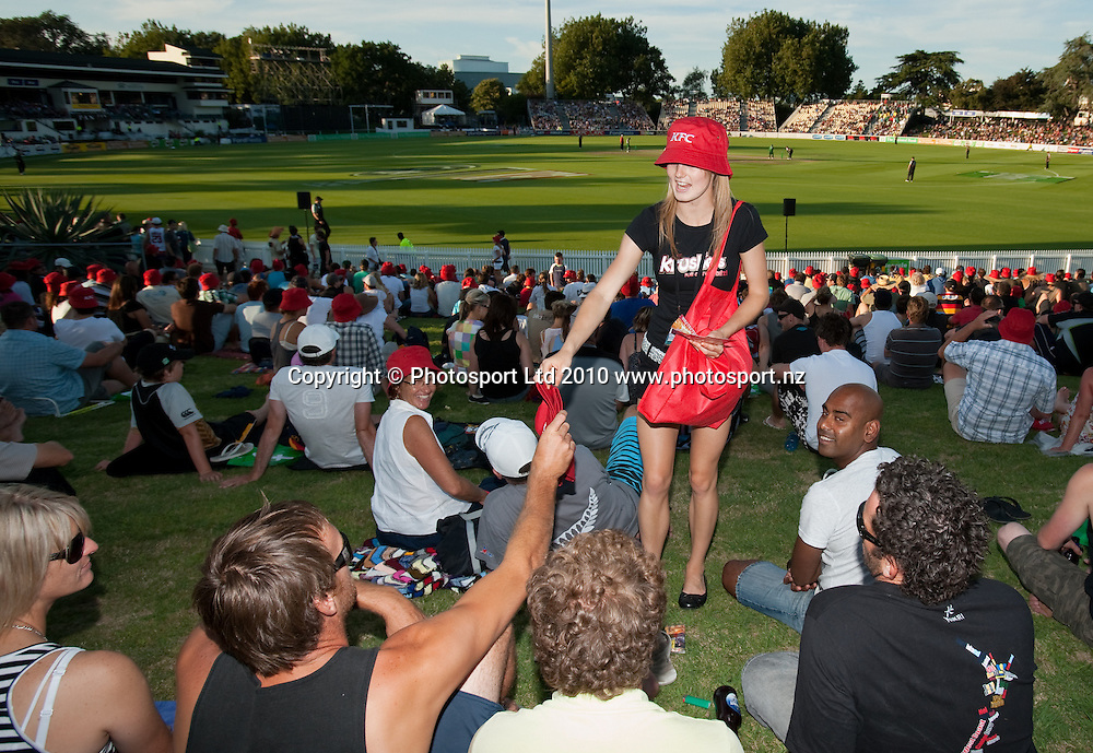 KFC Krushers promo girls give out hats and vouchers to fans in the crowd during the National Bank Twenty20 Series cricket match between Bangladesh and New Zealand Blackcaps won by 10 wickets by the Blackcaps at Seddon Park, Hamilton, New Zealand, Wednesday 03 February 2010. Photo: Stephen Barker/PHOTOSPORT