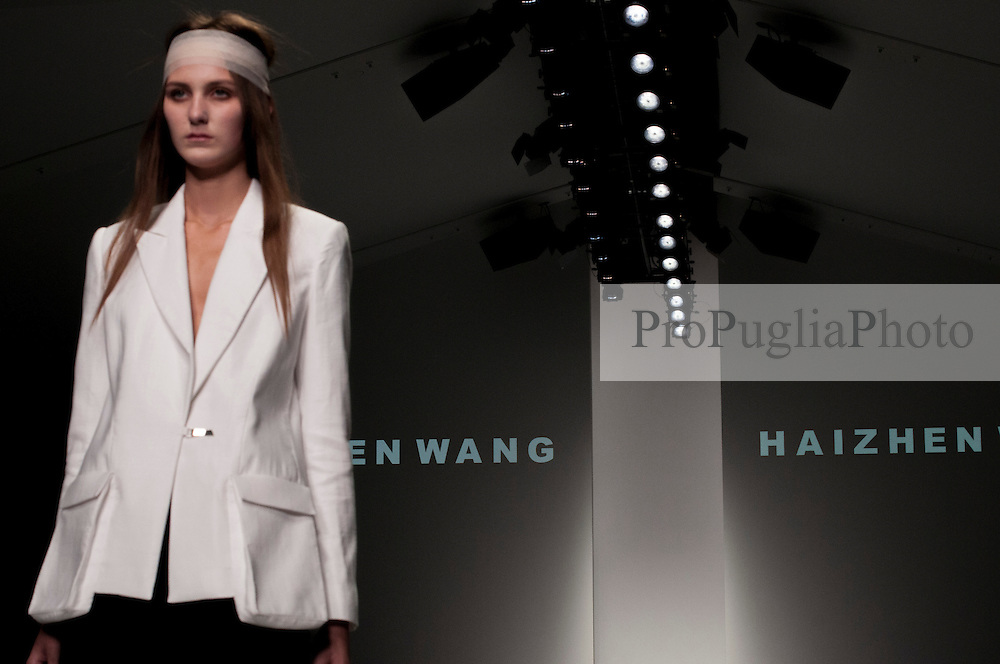 """London, 17 September 2013<br /> LONDON FASHION WEEK<br /> DESIGNER NAME: Haizhen Wang<br /> <br /> BACKGROUND: Haizhen is originally from Dalian, China. He graduated from Central Saint Martins with an MA (Hons) in Womenswear, having completed a BA (Hons) in Design Technology at London College of Fashion. After graduating he worked for Max Mara, Boudicca and All Saints.<br /> <br /> SIGNATURES: """"Masculine femininity with architectural references. Classical tailoring, bold design joined with precision and impeccable quality.""""<br /> <br /> TRADEMARK PIECE: """"Masculine, tailored jackets with an edge.""""<br /> <br /> IDEAL CLIENT: """"An extraordinary woman who is confident yet sensual and appreciates shape and form.""""<br /> Contact details<br /> Sales Contact<br /> <br /> Yui Tai<br /> sales@haizhenwang.co.uk<br /> Tel: +44 (0) 20 7836 7778<br /> Mobile: +44 (0) 7453 599077<br /> <br /> Press and Sales for North America <br /> greg@gregmillsshowroom.com<br /> Tel: +1 (0) 91 7991 889<br /> <br /> Press Contact<br /> <br /> Indie Nahal<br /> indie@haizhenwang.co.uk<br /> Tel: +44 (0) 79 4413 3531<br /> <br /> Dagmara Bandura<br /> press@haizhenwang.co.uk<br /> Tel: +44 (0) 79 2303 7172"""