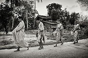 Young novice monks on their first walk for alms in rural Nakhon Nayok, Thailand. PHOTO BY LEE CRAKER