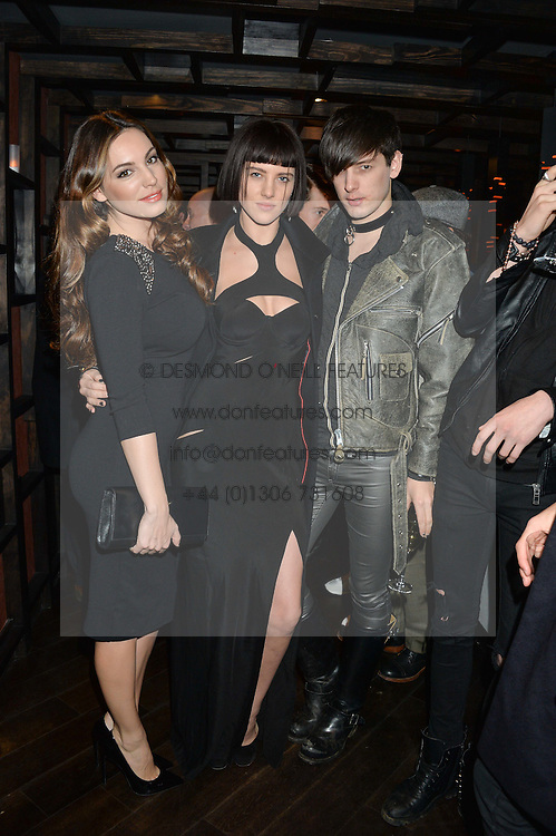 Left to right, KELLY BROOK, ELIZA CUMMINGS and DAMON BAKER at a birthday party for Kyle De'Volle hosted by Rita Ora at Bo Lang, 100 Draycott Avenue, London SW3 on 29th November 2013.
