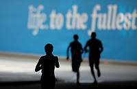 A silhouette of athletes emerging from Blackfriars underpass.  The Virgin Money London Marathon, 23rd April 2017.<br /> <br /> Photo: Ben Queenborough for Virgin Money London Marathon<br /> <br /> For further information: media@londonmarathonevents.co.uk