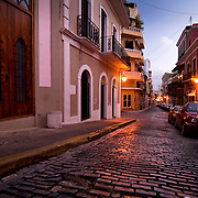 Street lamps illuminate the brick-cobbled streets shortly after dusk in Old San Juan, Puerto Rico.  Originally founded in 1508 by the Spanish explorer Juan Ponce de León, San Juan is today a thriving carribean outpost of the United States.