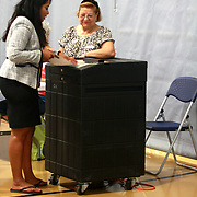 At 7:39am Juana Matia casts her ballot at Frost School in South Lawrence.  Matias, runs for Third District congressional seat leaf by US Representative Niki Tsongas. Photo: ©George Richardson