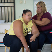 JULY 20, 2018---YABUCOA, PUERTO RICO----<br /> Sonielis Huertas, 10, and her mother Melisa Serrano, 37, <br /> in the Community School Jaime C. Rodriguez in Yabucoa, which is still under reconstruction months after the path of Hurricane Maria through the town.<br /> (Photo by Angel Valentin/Freelance)