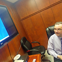Aberdeen School District Superintendent Jeff Clay looks at the main page of the StopIt app on the screen. The online reporting system gives students an anonymous way to report instances such as bullying and fighting to administrators.