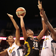 Nicole Powell, Tulsa Shock, attempts to shoot while challenged by Tina Charles (right) and Iziane Castro Marques, Connecticut Sun, during the Connecticut Sun V Tulsa Shock WNBA regular game at Mohegan Sun Arena, Uncasville, Connecticut, USA. 2nd July 2013. Photo Tim Clayton