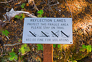 Trail sign on the Wonderland Trail protecting fragile area at Reflection Lakes, Mount Rainier National Park, Washington USA