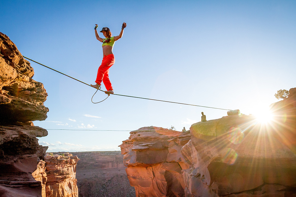 Hayley Ashburn with ankles tied together as her leash, walks over a 300' deep canyon.<br />