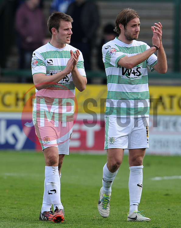 Yeovil Town's James Berrett  ad Yeovil Town's Sam Foley applaude the fans after their relegation to League Two was confirmed. - Photo mandatory by-line: Harry Trump/JMP - Mobile: 07966 386802 - 11/04/15 - SPORT - FOOTBALL - Sky Bet League One - Yeovil Town v Notts County - Huish Park, Yeovil, England.