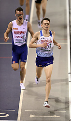 Great Britain's Chris O'Hare on his way to winning heat 2 of the men's 3000m with Norway's Henrik Ingebrigtsen behind during day one of the European Indoor Athletics Championships at the Emirates Arena, Glasgow.