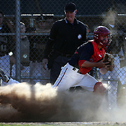 Mike Giordano, McMahon Senators, makes an out from a forced play at home plate during the High School Baseball ball game between Trumbull Golden Eagles and McMahon Senators at Brien McMahon High School. Norwalk, Connecticut. USA. 26th April 2012. Photo Tim Clayton