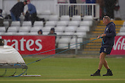 Ground staff protecting the wicket as rain falls during the LV County Championship Div 1 match between Durham County Cricket Club and Yorkshire County Cricket Club at the Emirates Durham ICG Ground, Chester-le-Street, United Kingdom on 28 June 2015. Photo by George Ledger.