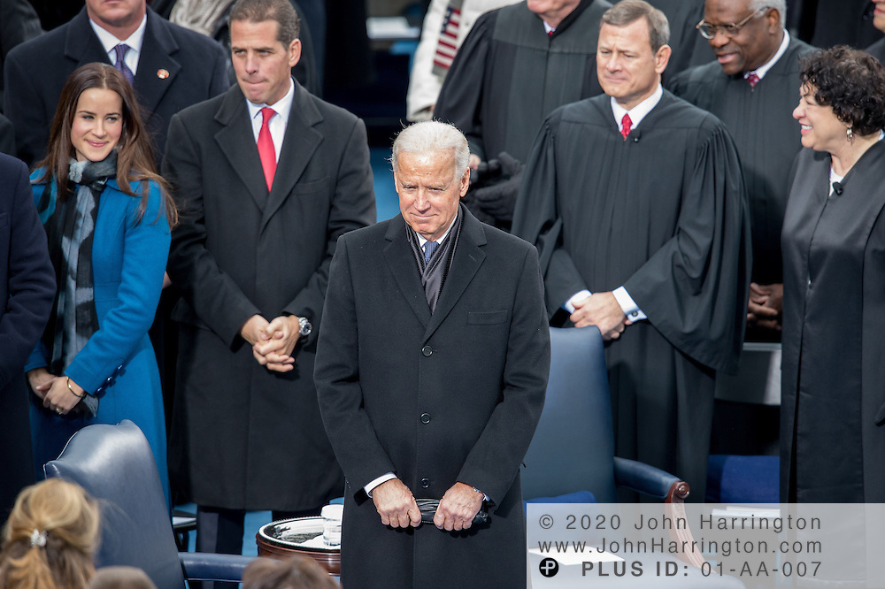 As Ashley Biden, Hunter Biden, Chief Justice John Roberts, Clarence Thomas, and Sonya Sotamayor look on, Vice President Biden arrives at the 57th Presidential Inauguration of President Barack Obama at the U.S. Capitol Building in Washington, DC January 21, 2013.