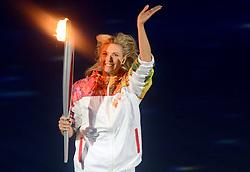 07-02-2014 ALGEMEEN: OPENINGSCEREMONIE OLYMPIC GAMES: SOTSJI<br /> De openingsceremonie in het Fishtstadion van de Olympische Winterspelen in Sotsji staat vol spektakel, dans en 22,5 ton vuurwerk / De vlam wordt binnen gebracht door Maria Sharapova<br /> ©2014-FotoHoogendoorn.nl
