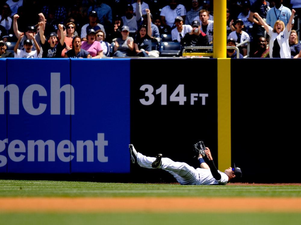 NEW YORK - MAY 15: Nick Swisher #33 of the New York Yankees falls after diving for a ball against the Minnesota Twins at Yankee Stadium on May 15, 2010 in the Bronx borough of Manhattan. The Yankees defeated the wins 7 to 1. (Photo by Rob Tringali) *** Local Caption ***  Nick Swisher