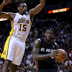 March 10, 2011; Miami, FL, USA; Miami Heat small forward LeBron James (6) drives past Los Angeles Lakers small forward Ron Artest (15) during the third quarter at the American Airlines Arena. The Heat defeated the Lakers 94-88.   Mandatory Credit: Derick E. Hingle