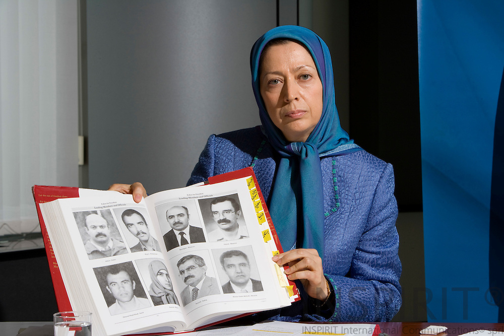 BRUSSELS - BELGIUM - 28 MAY 2008 -- Maryam RAJAVI, President-Elect of the National Council of Resistance of Iran, with a book showing executed resistance people.  Photo: Erik Luntang