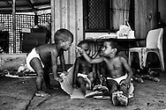 Kids playing at their family home in Kennedy Hill, despite poverty children are being children. Quane (1 yr), Meah (3 yr), Kitana (3 yr) and Marjorie (4 yr) (from L to R), Broome, Western Australia. &copy;Ingetje Tadros/Diimex<br /> <br /> Honorable Mention-Photo Essay ND Awards 2015