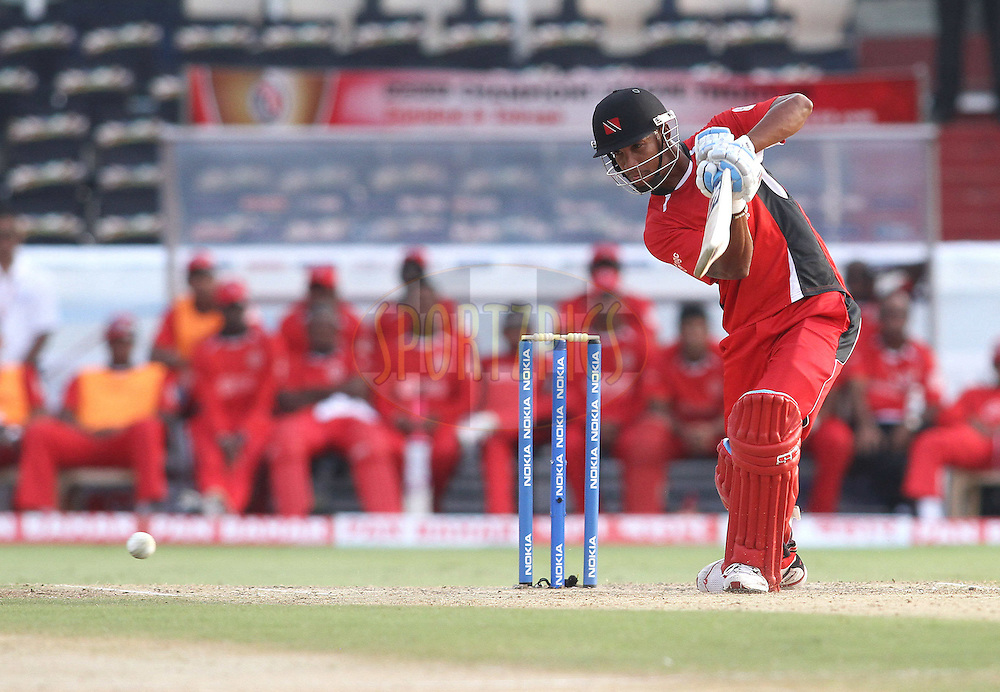 Lendl Simmons of Trinidad and Tobago cover drives a delivery during the CLT20 - Q3 match between Trinidad and Tobago and Leicestershire Foxes held at the Rajiv Gandhi International Stadium, Hyderabad on the 20th September 2011..Photo by Shaun Roy/BCCI/SPORTZPICS