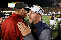 Nov 4, 2017; Morgantown, WV, USA; West Virginia Mountaineers head coach Dana Holgorsen talks with Iowa State Cyclones head coach Matt Campbell after the game at Milan Puskar Stadium. Mandatory Credit: Ben Queen-USA TODAY Sports
