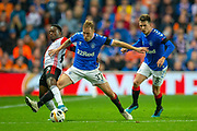 Scott Arfield (#37) of Rangers FC tackles Ridgeciano Haps (#5) of Feyenoord Rotterdam as Ryan Jack (#8) of Rangers FC watches on during the Europa League match between Rangers FC and Feyenoord Rotterdam at Ibrox Stadium, Glasgow, Scotland on 19 September 2019.