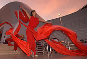A ribbon dancer performs during a rehearsal in front of the Walt Disney Concert Halll.