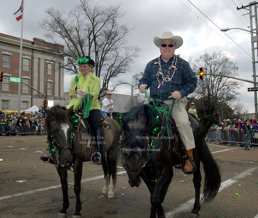 Haley Barbour Governor of Mississippi, and his wife first lady Marsha Barbour are seen riding horses in the 2005 Mal's St. Paddy's Day Parade riding down Capitol Street in Jackson MS March 18,2005. Governor Barbour is seen throwing beads and holding tight to the reins as he rides down capitol street. Barbour's response to the Deepwater Horizon Spill has been clearly on the side of Big Business and with an eye towards the 2012 Presidential Election. Barbour is now ranked as the most powerful Republican in his Party. Photo© Suzi Altman