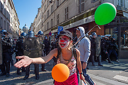 © Licensed to London News Pictures. 21/09/2019. Paris, France. A protester stands in front of French riot police at a climate change demonstration in Paris. Photo credit: Peter Manning/LNP
