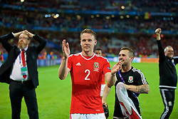 LILLE, FRANCE - Friday, July 1, 2016: Wales' Chris Gunter celebrates after a 3-1 victory over Belgium and reaching the Semi-Final during the UEFA Euro 2016 Championship Quarter-Final match at the Stade Pierre Mauroy. Chris Senior. (Pic by David Rawcliffe/Propaganda)
