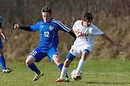 Mt. Anthony's William Shea (11) battles for the ball with CVU's Dillon Hamrell (1) during the boys semifinal soccer game between Mount Anthony and Champlain Valley Union at CVU high school on Tuesday afternoon October 27, 2015 in Hinesburg. (BRIAN JENKINS/ for the FREE PRESS)