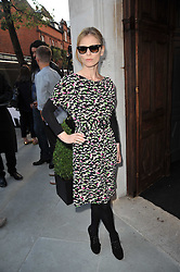 EMILIA FOX at the opening party for Nicholas Kirkwood's new store at 5 Mount Street, London on 12th May 2011.