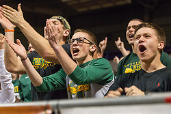 Huntington fans erupt after a foul is called during the Class AAA championship game at the Charleston Civic Center.