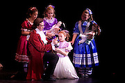 Uncle Drosselmeyer (Benjamin Pomerance) and Claire (Martina Viadana) with Claire's friends during the North Country Ballet Ensemble's 2008 production of the Nutcracker at the Hartman Theatre, Plattsburgh State University, Plattsburgh, N.Y.  (Photo/Todd Bissonette - www.rtbphoto.com)