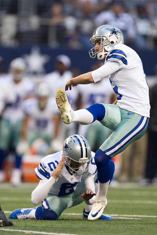 ARLINGTON, TX - NOVEMBER 18:  Dan Bailey #5 of the Dallas Cowboys kicks a extra point against the Cleveland Browns at Cowboys Stadium on November 18, 2012 in Arlington, Texas.  The Cowboys defeated the Browns 23-20.  (Photo by Wesley Hitt/Getty Images) *** Local Caption *** Dan Bailey