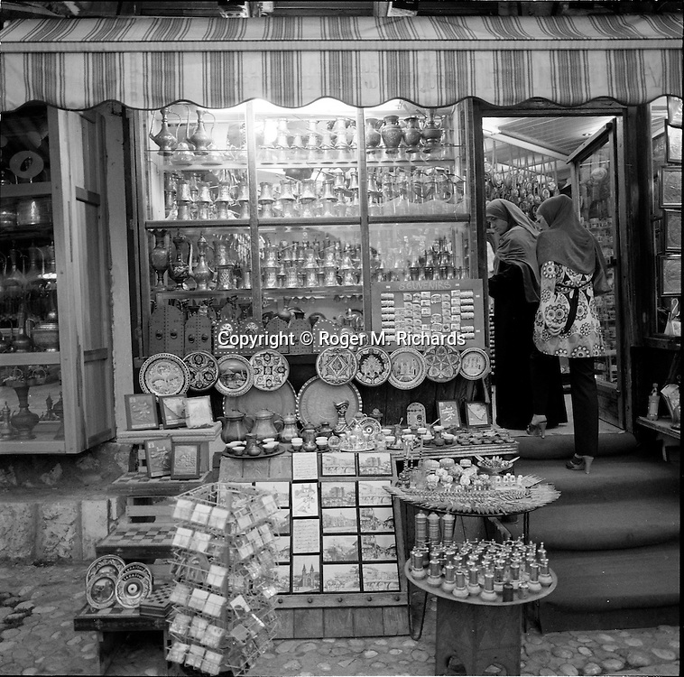 Two women enter a shop in the central square of Bascarsija, in the old town of Sarajevo, July 2008.