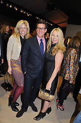 Left to right, STACY McLAUGHLAN, MICHAEL BRUNO founder of online luxury marketplace 1stdibs and CLAIR WATSON at a preview evening of the annual London LAPADA (The Association of Art & Antiques Dealers) antiques Fair held in Berkeley Square, London on 18th September 2012.