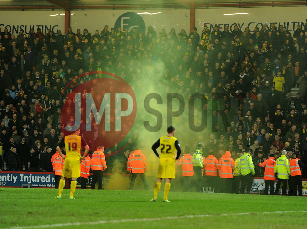 Watford fans let of a off a flare. - Photo mandatory by-line: Alex James/JMP - Tel: Mobile: 07966 386802 18/01/2014 - SPORT - FOOTBALL - Goldsands Stadium - Bournemouth - Bournemouth v Watford - Sky Bet Championship