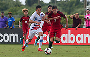 Team USA forward Christian Torres (9) and Portugal defender Antonio Teixeira (3) fight for possession of the ball during a CONCACAF boys under-15 championship soccer game, Saturday, August 10, 2019, in Bradenton, Fla. Portugal defeated Team USA 3-0 and advanced to the finals against Slovenia. (Kim Hukari/Image of Sport)