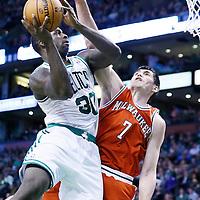 21 December 2012: Boston Celtics power forward Brandon Bass (30) goes for the layup over Milwaukee Bucks small forward Ersan Ilyasova (7) during the Milwaukee Bucks 99-94 overtime victory over the Boston Celtics at the TD Garden, Boston, Massachusetts, USA.